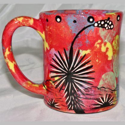 Mana Pottery e-mug featuring hummingbird and desert landscape on reverse sides, on crimson background.