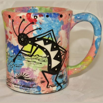 Mana Pottery e-mug featuring kokopelli and desert landscape on reverse sides, on coral background.