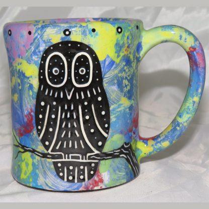 Mana Pottery e-mug featuring owl and desert landscape on reverse sides, on blue background.