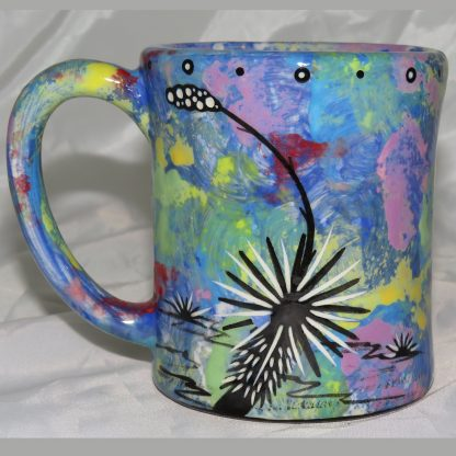 Mana Pottery e-mug featuring owl and desert landscape on reverse sides, on blue background.