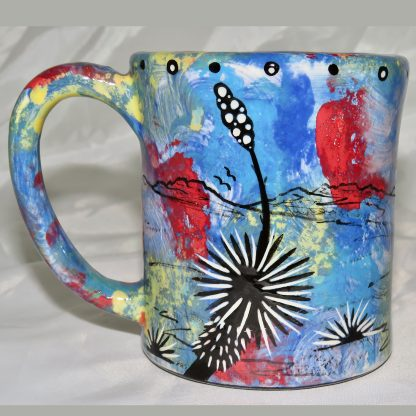 Mana Pottery e-mug featuring American Paint horse and desert landscape on reverse sides, on blue background.