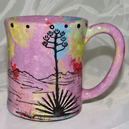 Mana Pottery e-mug featuring puma lion and desert landscape on reverse sides, on lilac background.