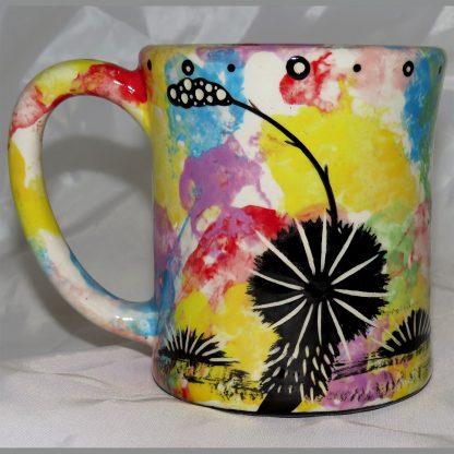 Mana Pottery e-mug featuring roadrunner and desert landscape on reverse sides, on confetti background.