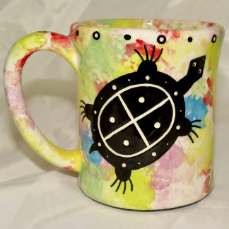Mana Pottery e-mug featuring turtle and desert landscape on reverse sides, on confetti background.