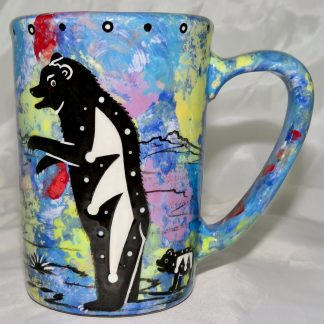 Mana Pottery Large Mug featuring bear and desert landscape on reverse sides, on blue background.