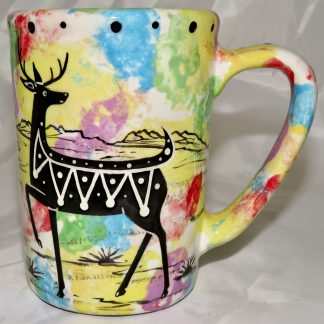 Mana Pottery Large Mug featuring deer and desert landscape on reverse sides, on mixed color background.