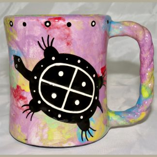 Mana Pottery Rope Mug featuring turtle on one side and desert vegetation on reverse, on green