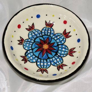 Mana Pottery tea bag holder featuring blue Peyote buttons in bloom