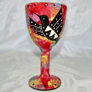 Mana Pottery goblet featuring hummingbird on one side and native Aravaipa desert vegetation on reverse, on crimson background.