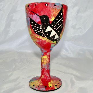 Mana Pottery goblet featuring hummingbird on one side and native Aravaipa desert vegetation on reverse, on crimson background.