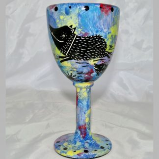 Mana Pottery goblet featuring javelina with baby on one side and native Aravaipa desert vegetation on reverse, on blue background.