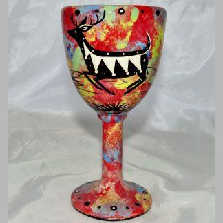 Mana Pottery goblet featuring jumping deer on one side and native Aravaipa desert vegetation on reverse, on crimson background.