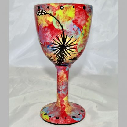 Mana Pottery goblet featuring jumping deer on one side and native Aravaipa desert vegetation on reverse, on crimson background.