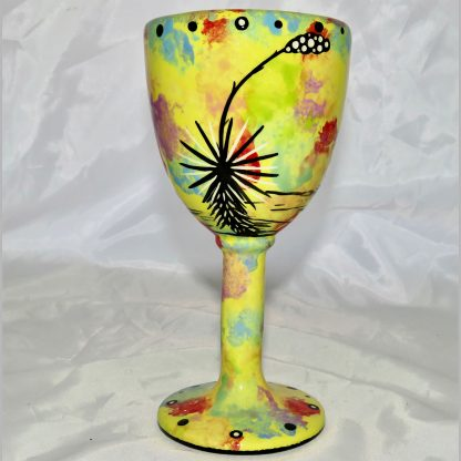 Mana Pottery goblet featuring roadrunner on one side and native Aravaipa desert vegetation on reverse, on bright yellow background.