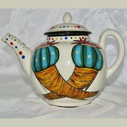 Mana Pottery Peyote Duo teapot with Firebird on reverse side.