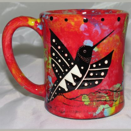 Mana Pottery e-mug featuring hummingbird with desert landscape on reverse, on crimson background. For left handers.