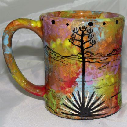 Mana Pottery e-mug featuring javelina family with desert landscape on reverse.