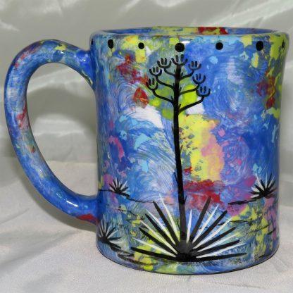 Mana Pottery e-mug featuring kokopelli with desert landscape on reverse.