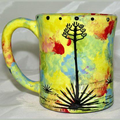 Mana Pottery e-mug featuring wolf with desert landscape on reverse.