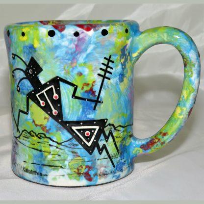 Mana Pottery e-mug featuring yeibichai with desert landscape on reverse.