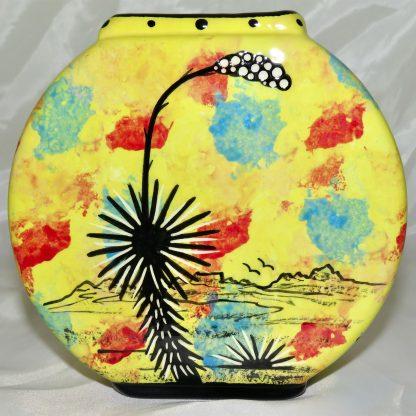 Mana Pottery pillow vase featuring hummingbird with desert landscape on reverse.