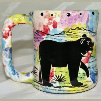 Mana Pottery rope mug featuring bear and desert landscape on reverse.