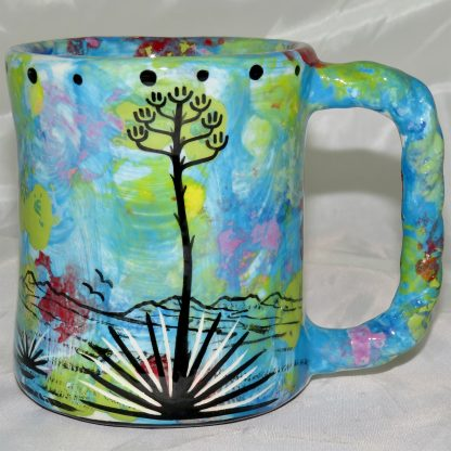 Mana Pottery rope mug featuring Yeibichai with desert landscape on reverse. For left handers.