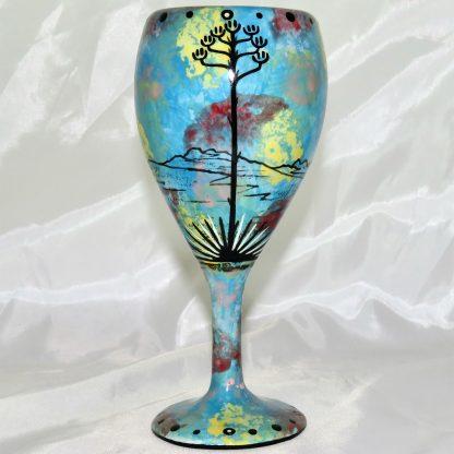 Mana Pottery wine glass featuring hawk in flight with desert landscape on reverse.