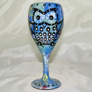 Mana Pottery wine glass featuring owl with desert landscape on reverse.