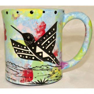 Mana Pottery e-mug featuring hummingbird and desert landscape on reverse sides, on turquoise blue background.