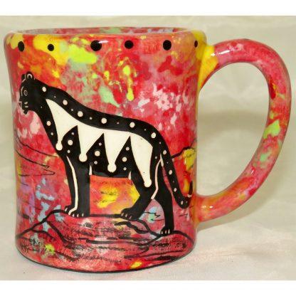 Mana Pottery e-mug featuring puma lion and desert landscape on reverse sides, on crimson background.