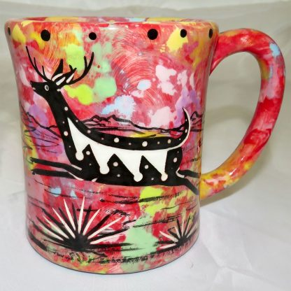 Mana Pottery e-mug featuring running deer and desert landscape on reverse sides, on crimson background.