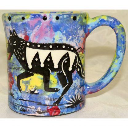 Mana Pottery e-mug featuring wolf and desert landscape on reverse sides, on blue background.