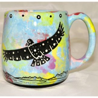 Mana Pottery country cup featuring hawk in flight and desert vegetation on reverse sides, on turquoise blue background.