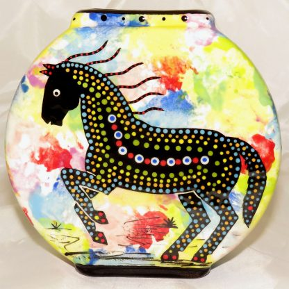 Mana Pottery pillow vase featuring horse and desert landscape on reverse sides, on confetti background..