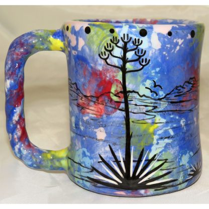 Mana Pottery rope mug featuring running deer and desert landscape on reverse sides, on blue background.