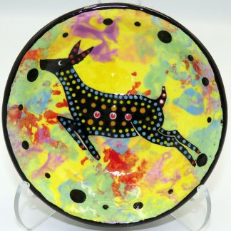 Mana Pottery teabag holder featuring leaping deer on bright yellow